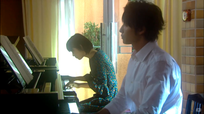 "Although Nodame played it in her own ""abnormal"" way, Chiaki could still complement her perfectly with his skills and careful observation. Mozart Double Piano. With Chiaki's instruction, Nodame's persistency and willingness leads to their small but first success. It also marks the beginning of their relationship."