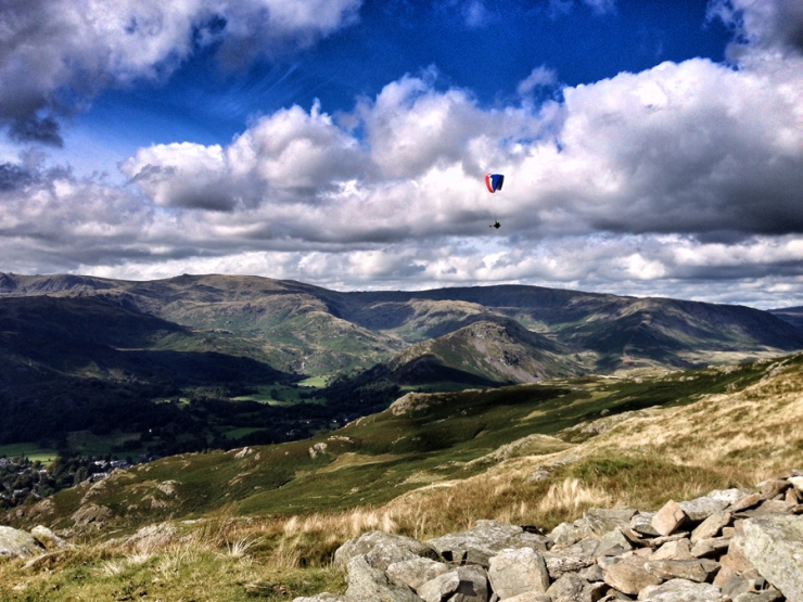 "Two paragliders floated effortlessly along the valley of Grasmere. Our topic began with ""I'd love to try"" and ended with ""I wonder how much the insurance would cost"" and some extreme sport disasters on the news..."